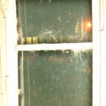 Jenny's phantom tabby in the upper window frame