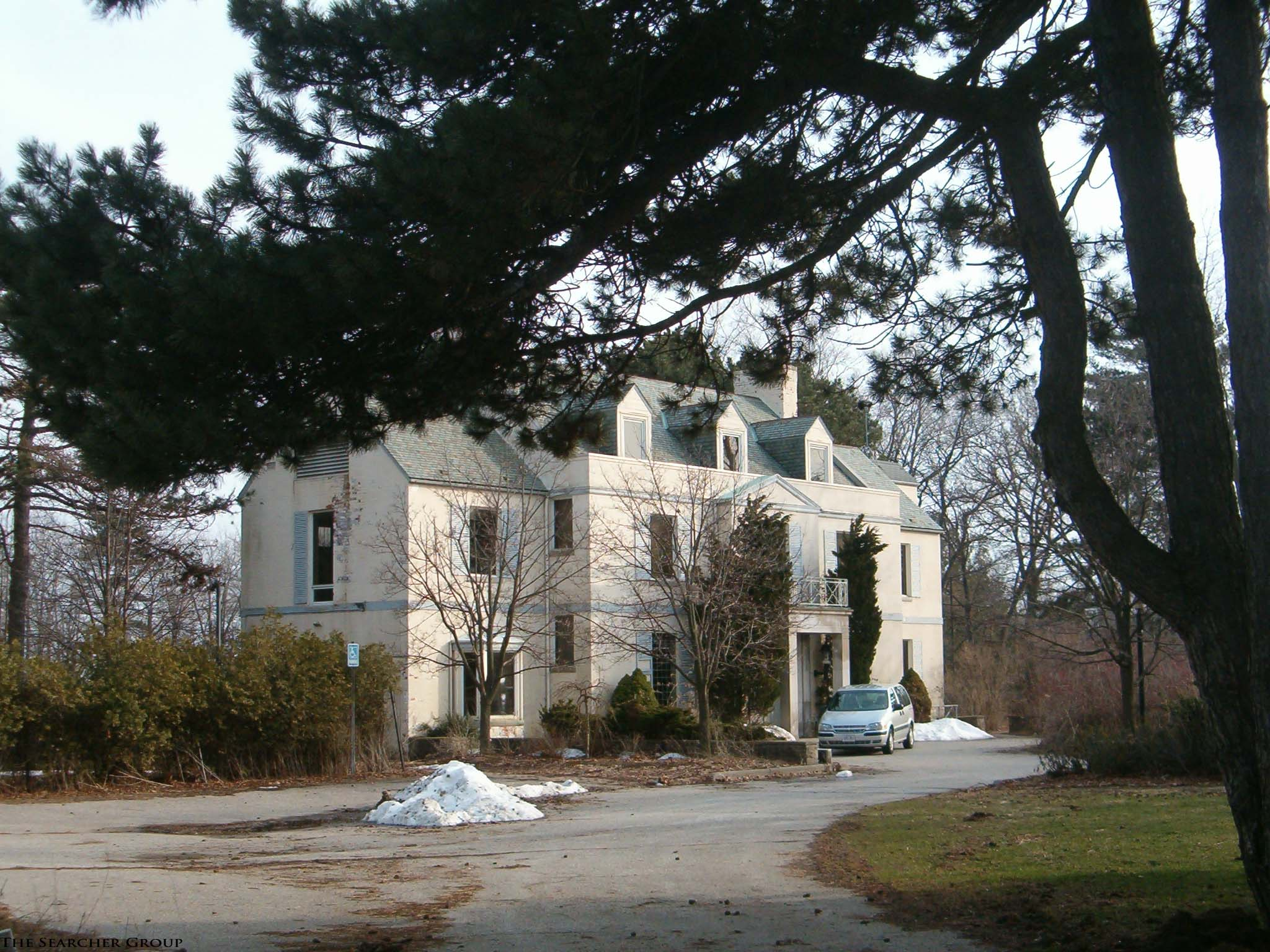 photo of Fusion house, large white house with driveway in front