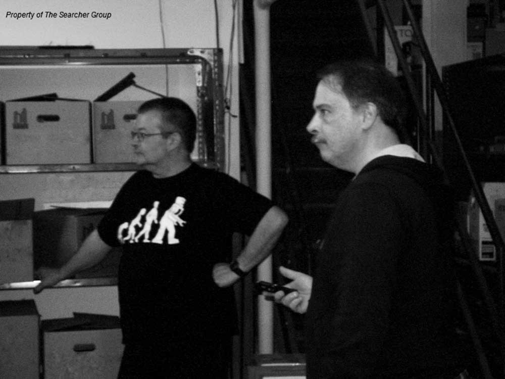 black and white photo of Richard and John investigating