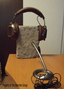 Stone with headphone and microphone